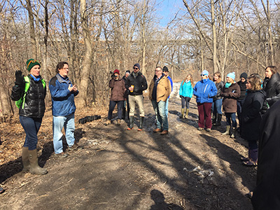 The MNRRA collaborators exploring an urban floodplain forest in the City of Saint Paul, MN