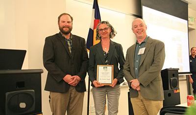 Dr. Linda Nagel receiving the 2019 CO/WY SAF Citizenship Award, with the CO/WY SAF Awards Chair (Sam Pankratz) and the CO/WY Chapter Chair (Chris Farley); Photo Credit: Phil Hoefer